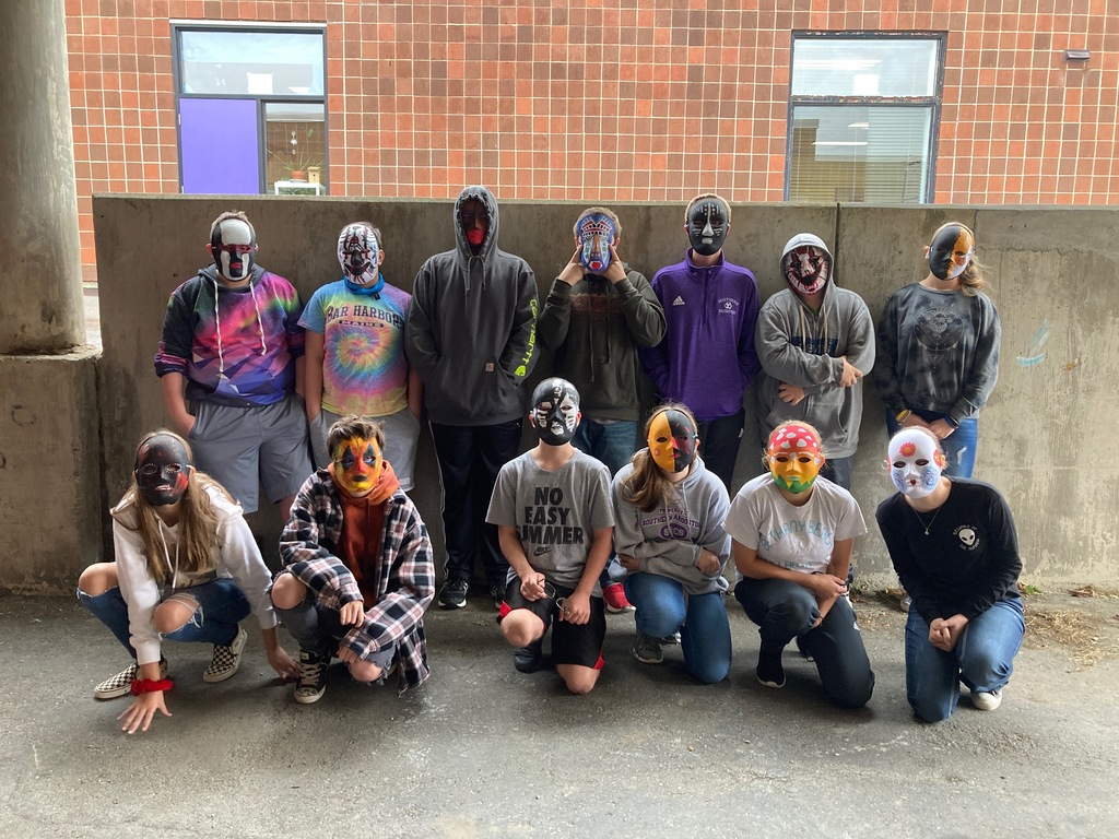8th Grade Geography Class wearing African masks
