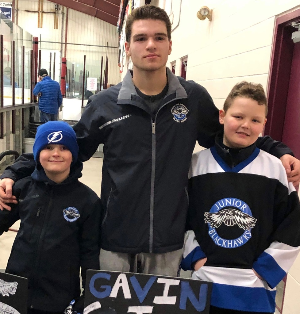 SACS Senior Hockey Player Gavin Vining Pictured with two Junior BlackHawks players on Senior Night