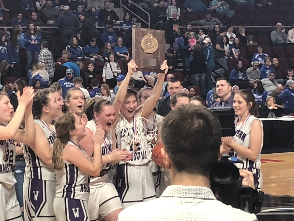 Sacs Girls Basketball team holding championship trophy
